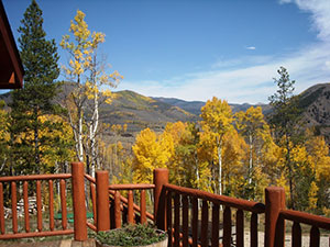 view of fall aspens and the hills from a deck in Shadow Mountain Ranch